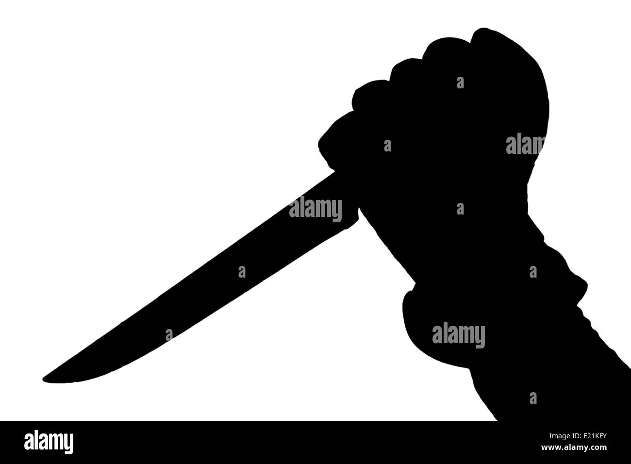 Silhouette of hand holding a knife - Stock Image