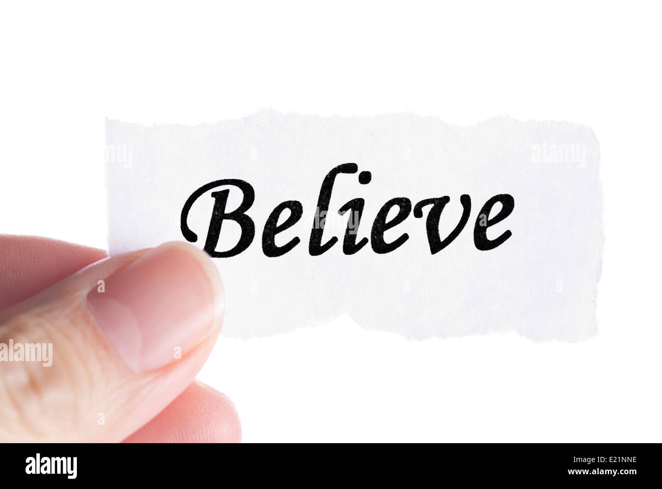 Believe word in finger - Stock Image