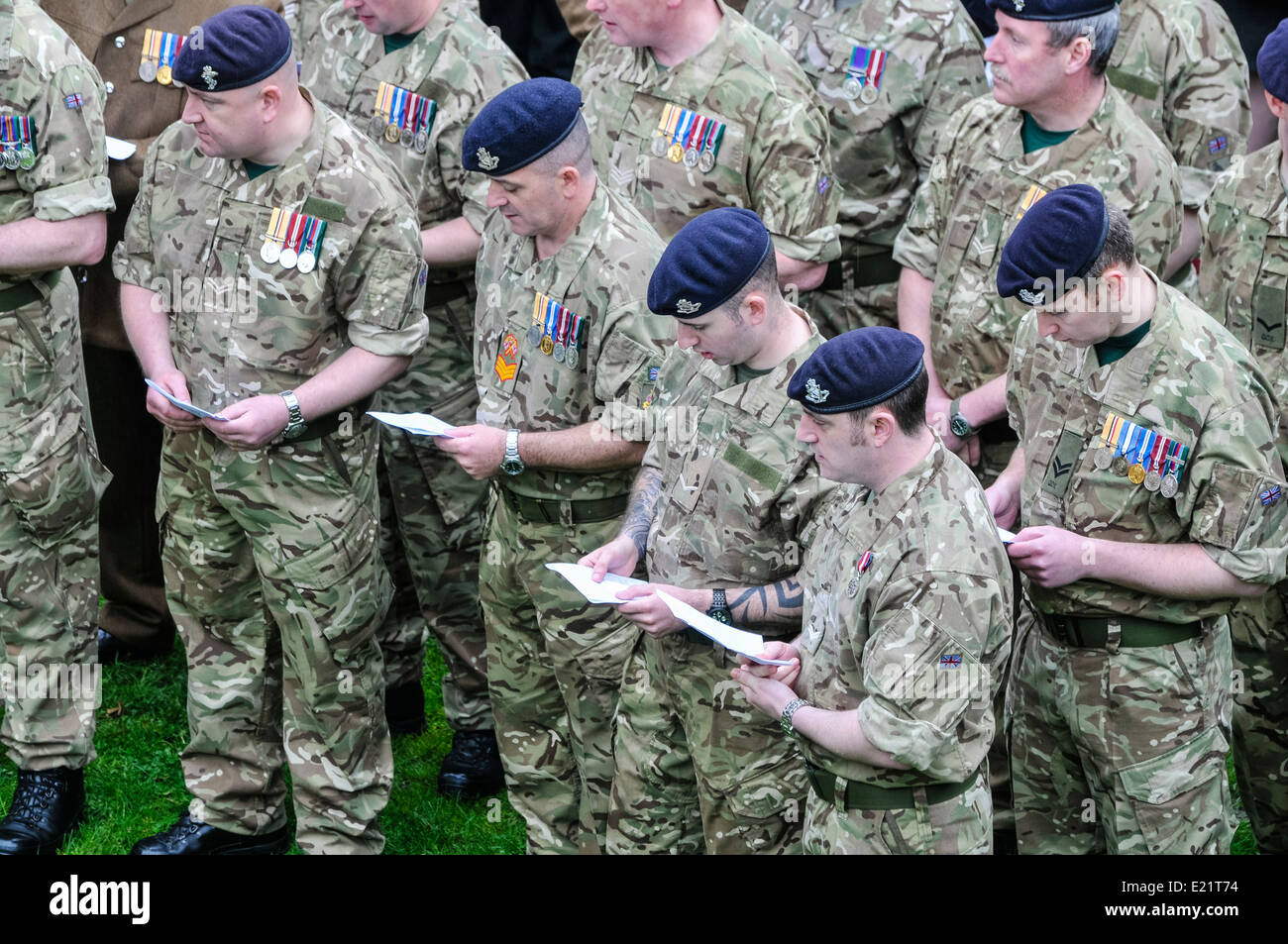 Soldiers from North Irish Horse regiment sing hymns from an