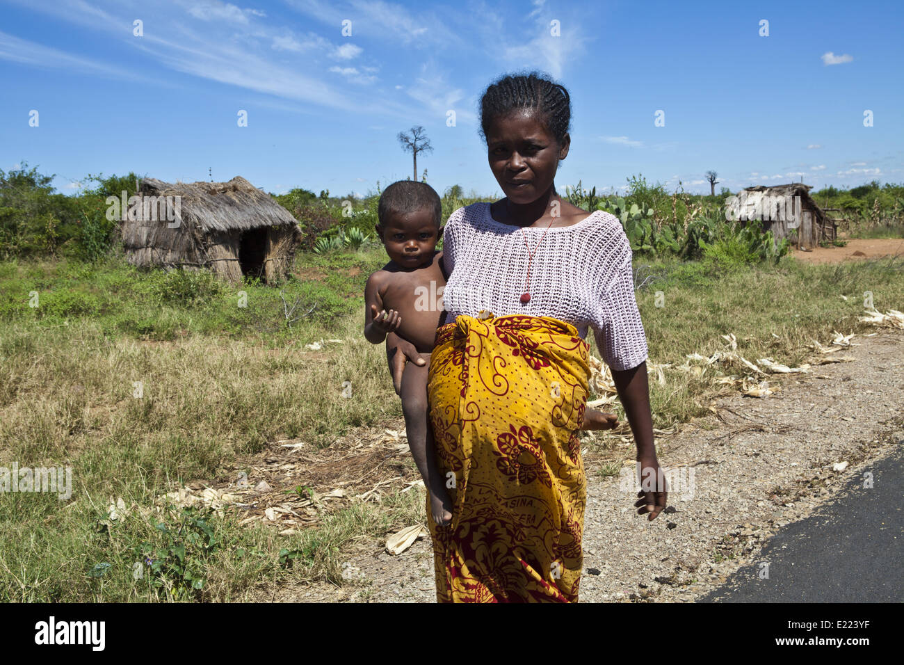 Pregnant african woman with child, Madagascar - Stock Image