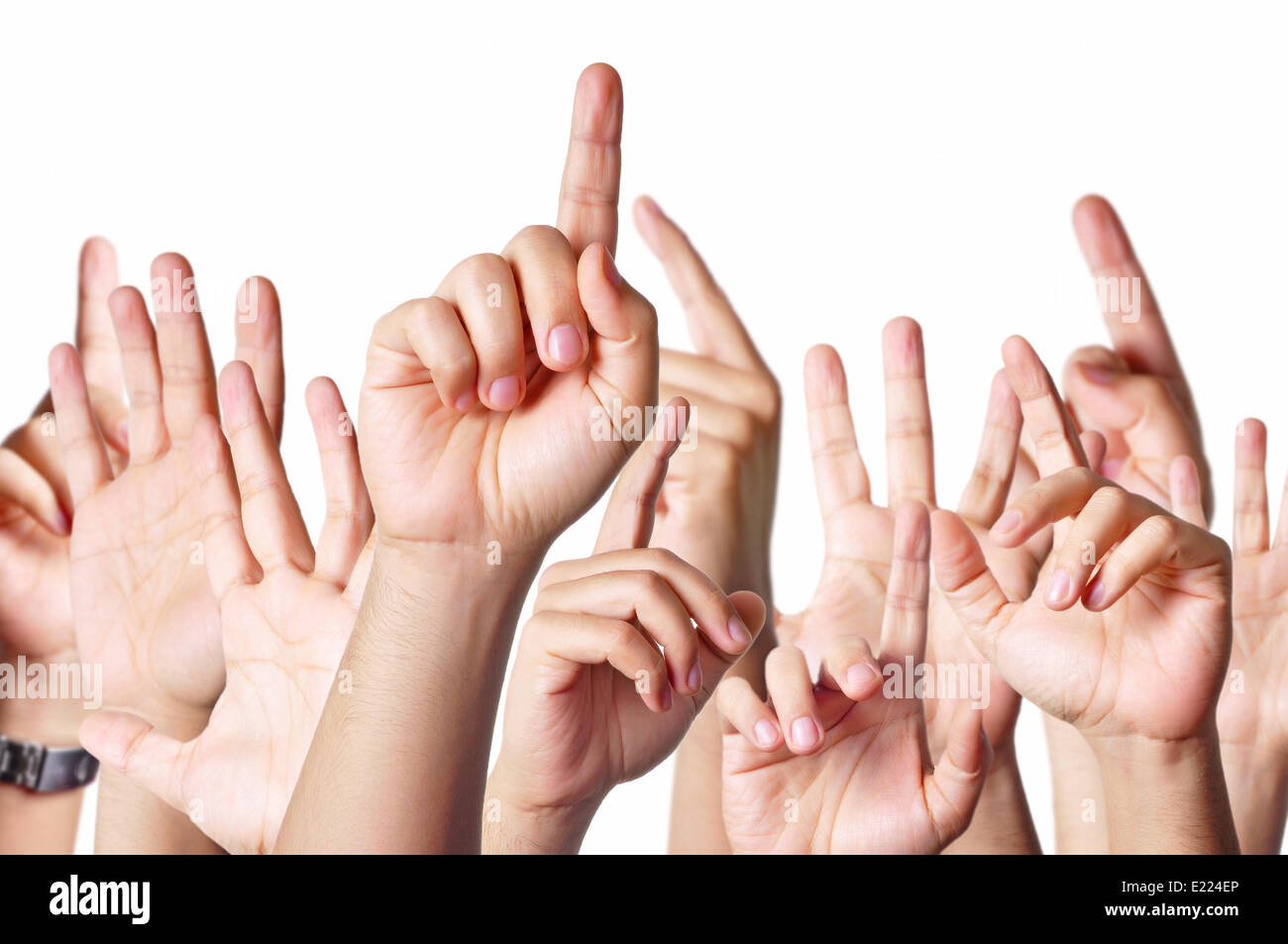 Hands raised together - Stock Image