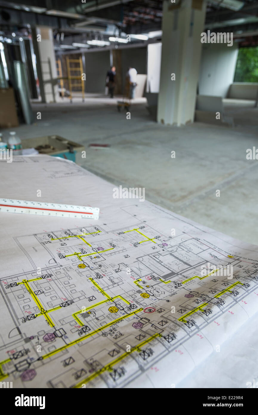Blueprints In Commercial Construction Site Interior - Stock Image