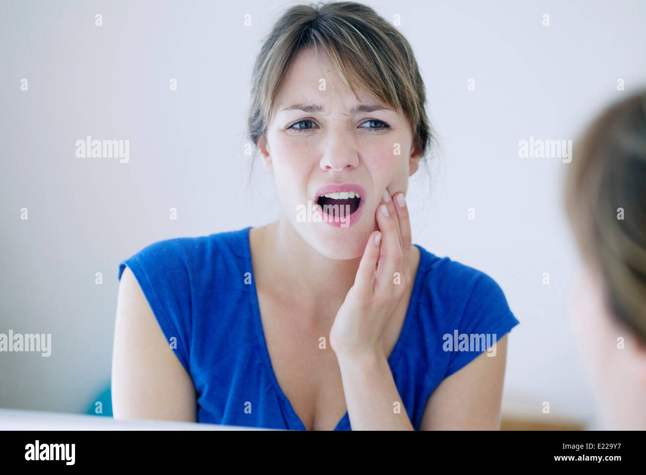 Woman with a toothache - Stock Image