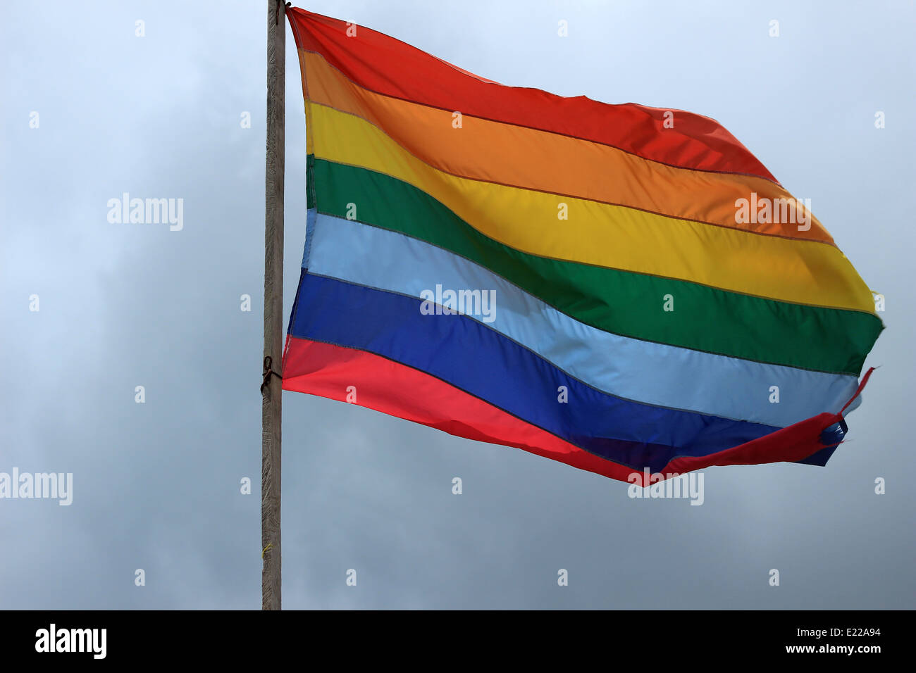 The striped flag of the indigenous people of Ecuador flying in Cotacachi, Ecuador - Stock Image