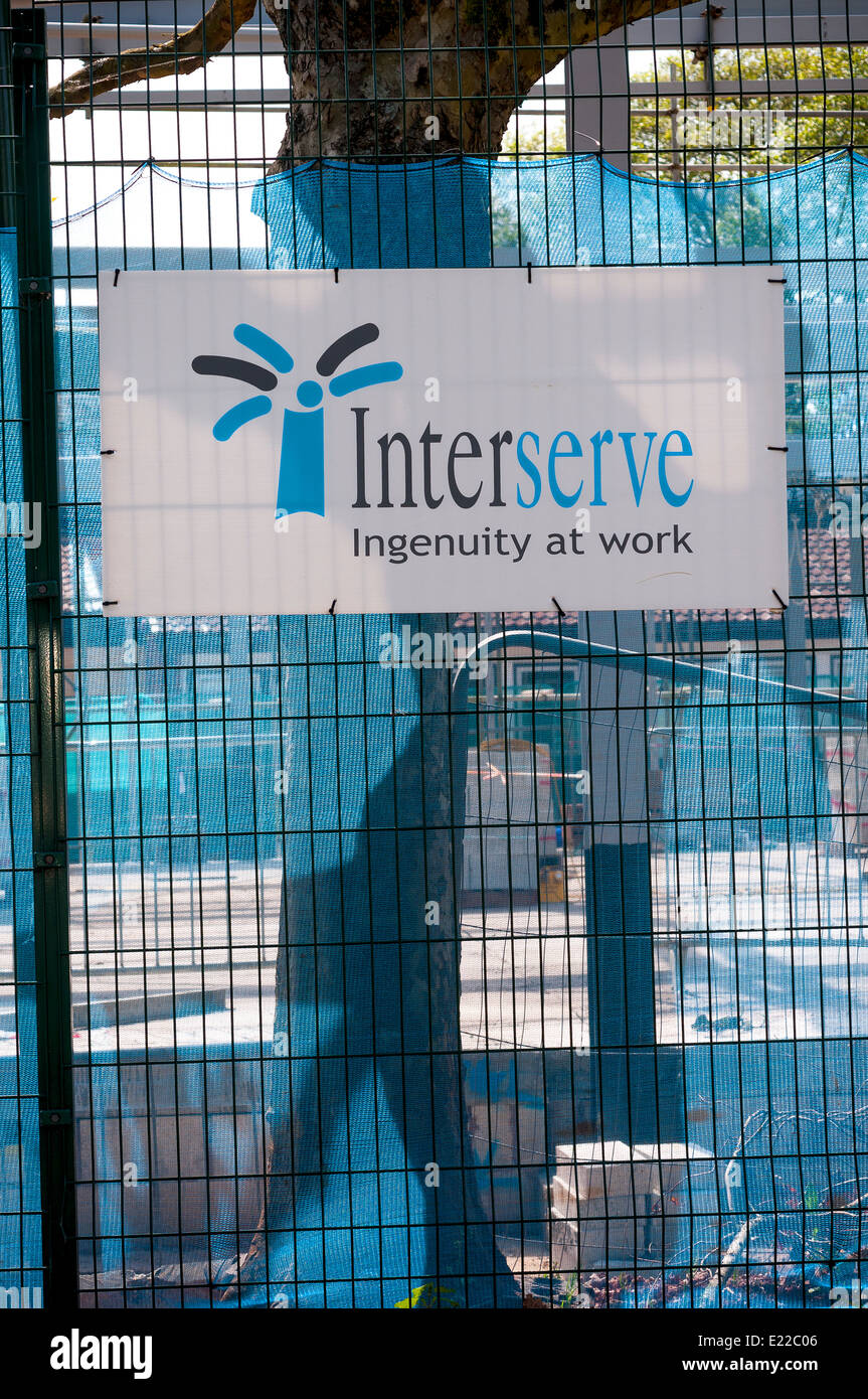 interserve, ingenuity at work,scaffold, rise, workers, square, housing, steel, net, green, construct, Interserve, - Stock Image