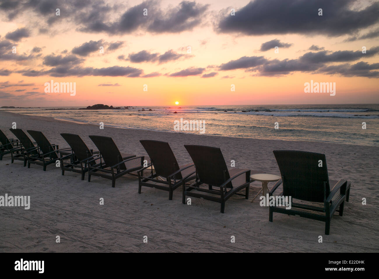 Sunset on beach with beach chairs at Punta Mita, Mexico. - Stock Image