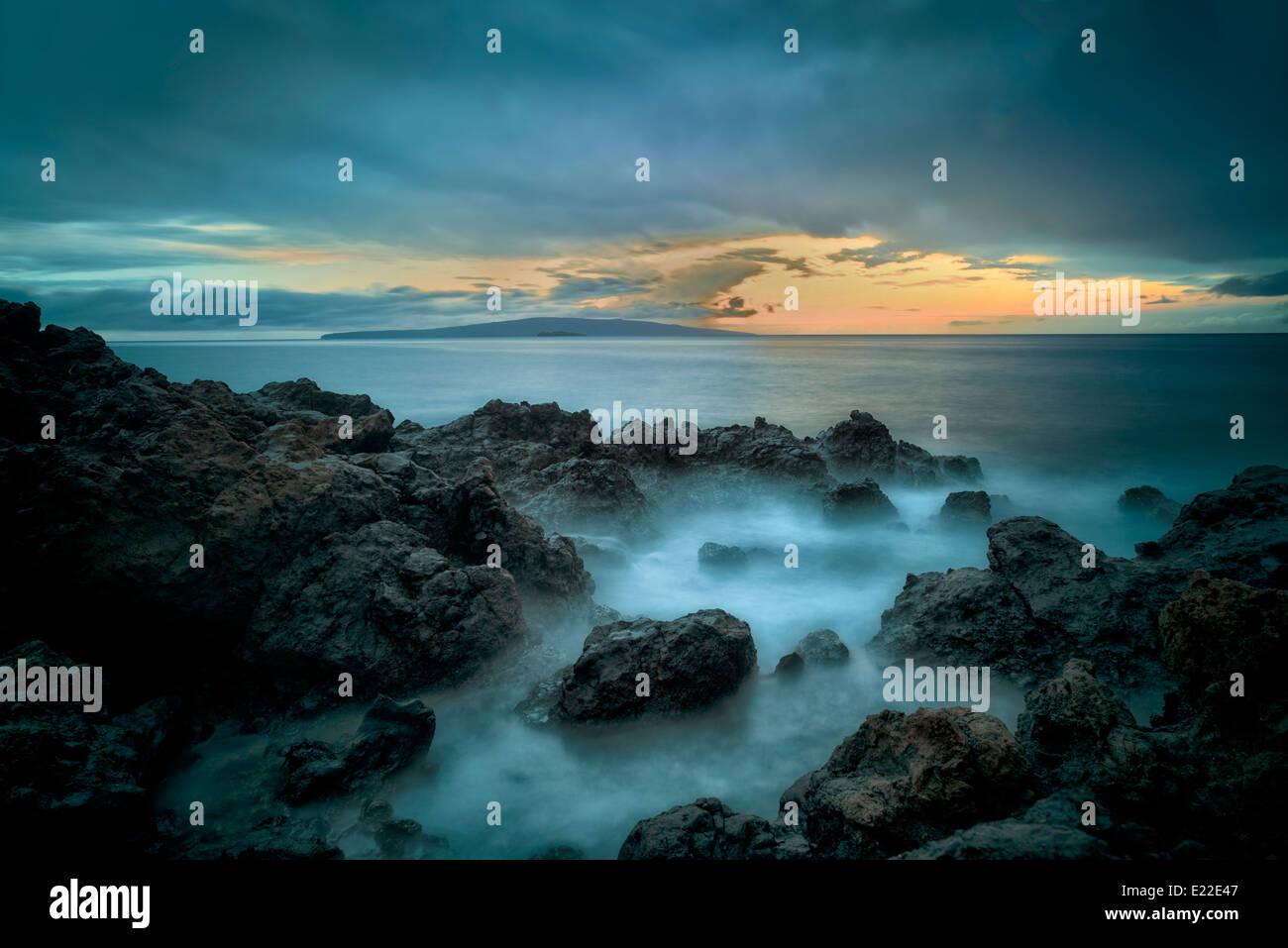 Sunset and rocky coastline. Maui, Hawaii - Stock Image