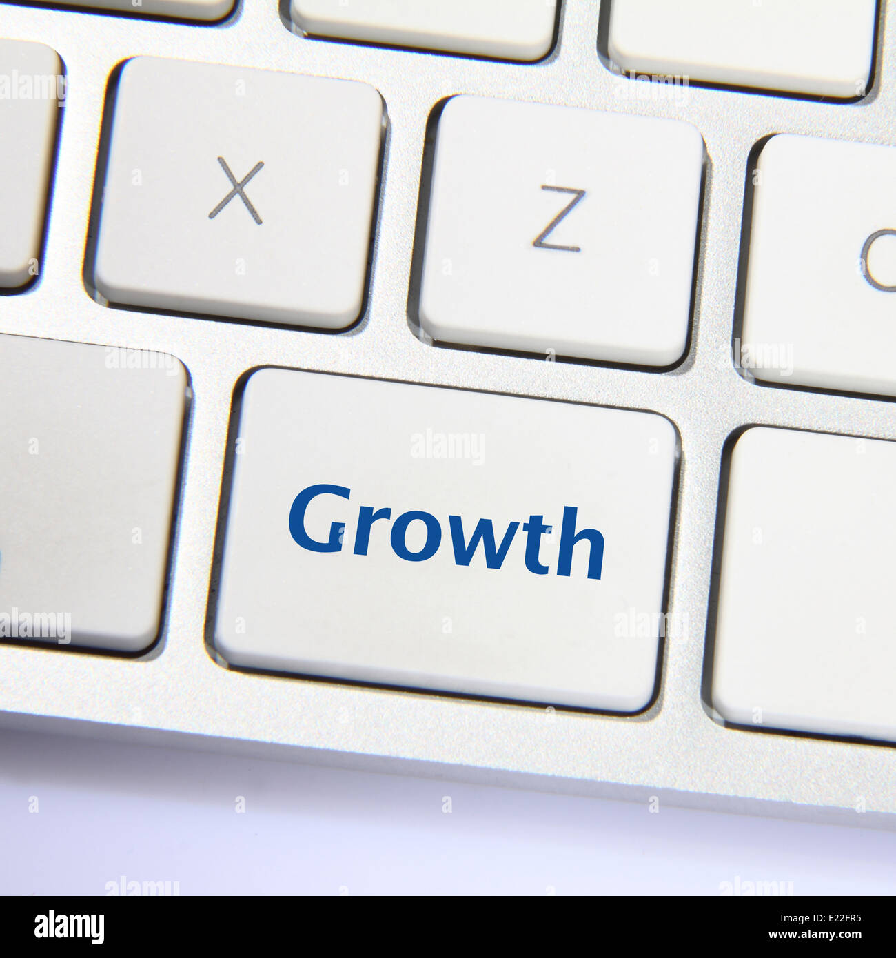 Photo of growth button on the white keyboard. Stock Photo