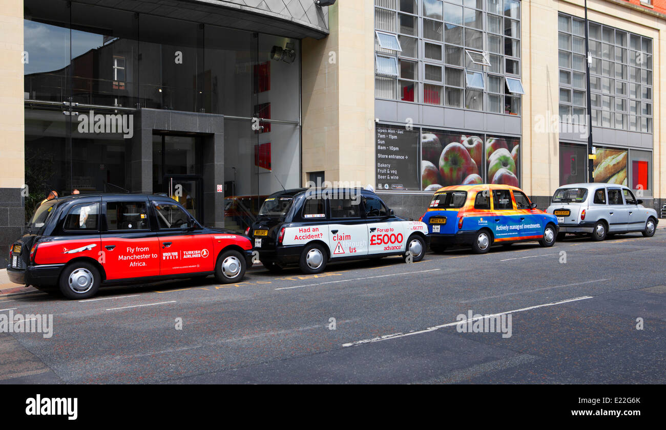 Hackney Cabs, Private Hire Vehicles for hire  Taxis in Manchester City Centre, Lancashire, UK Stock Photo