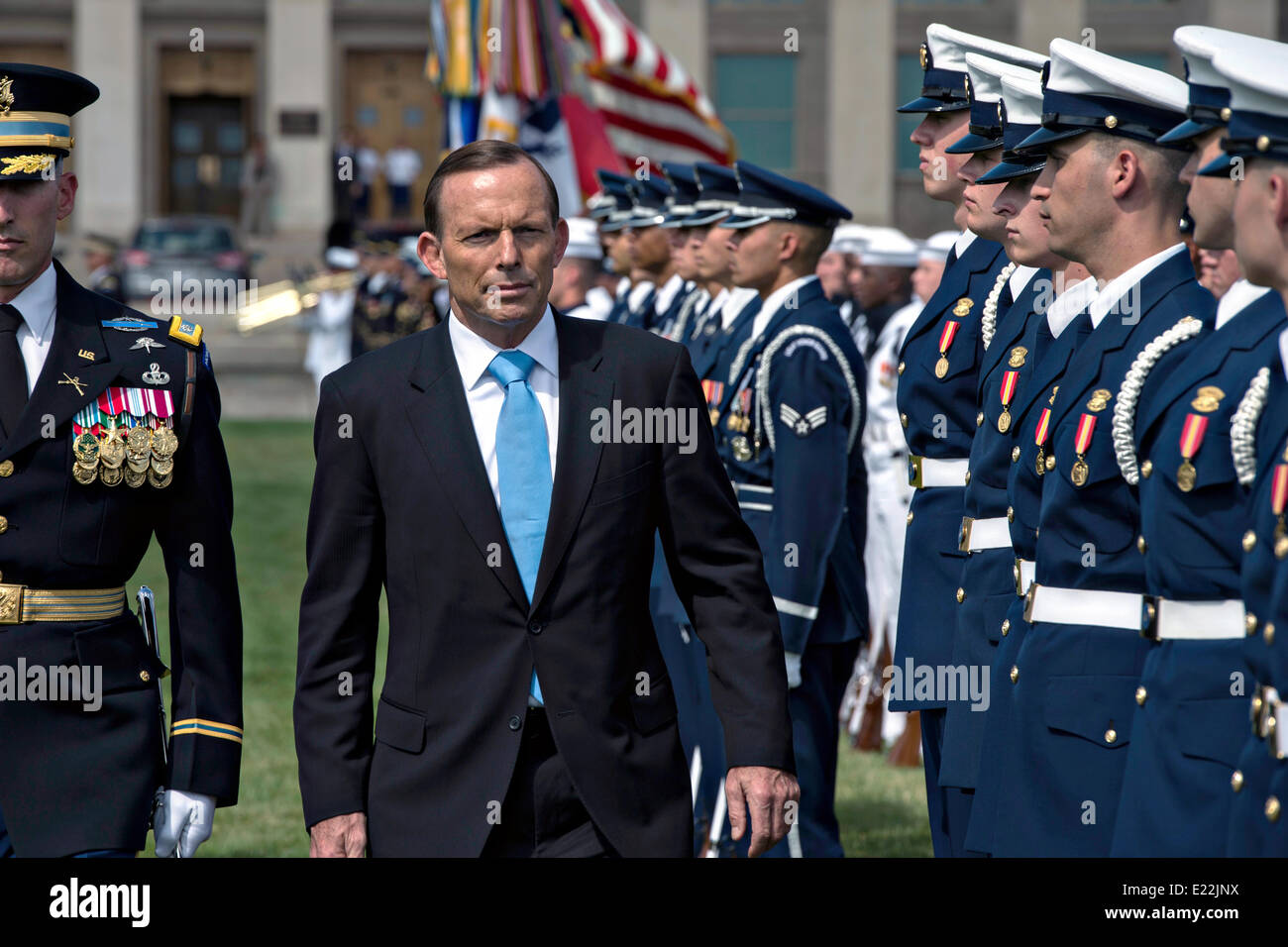 Australian Prime Minister Tony Abbott reviews the honor guard during an arrival ceremony at the Pentagon June 13, - Stock Image