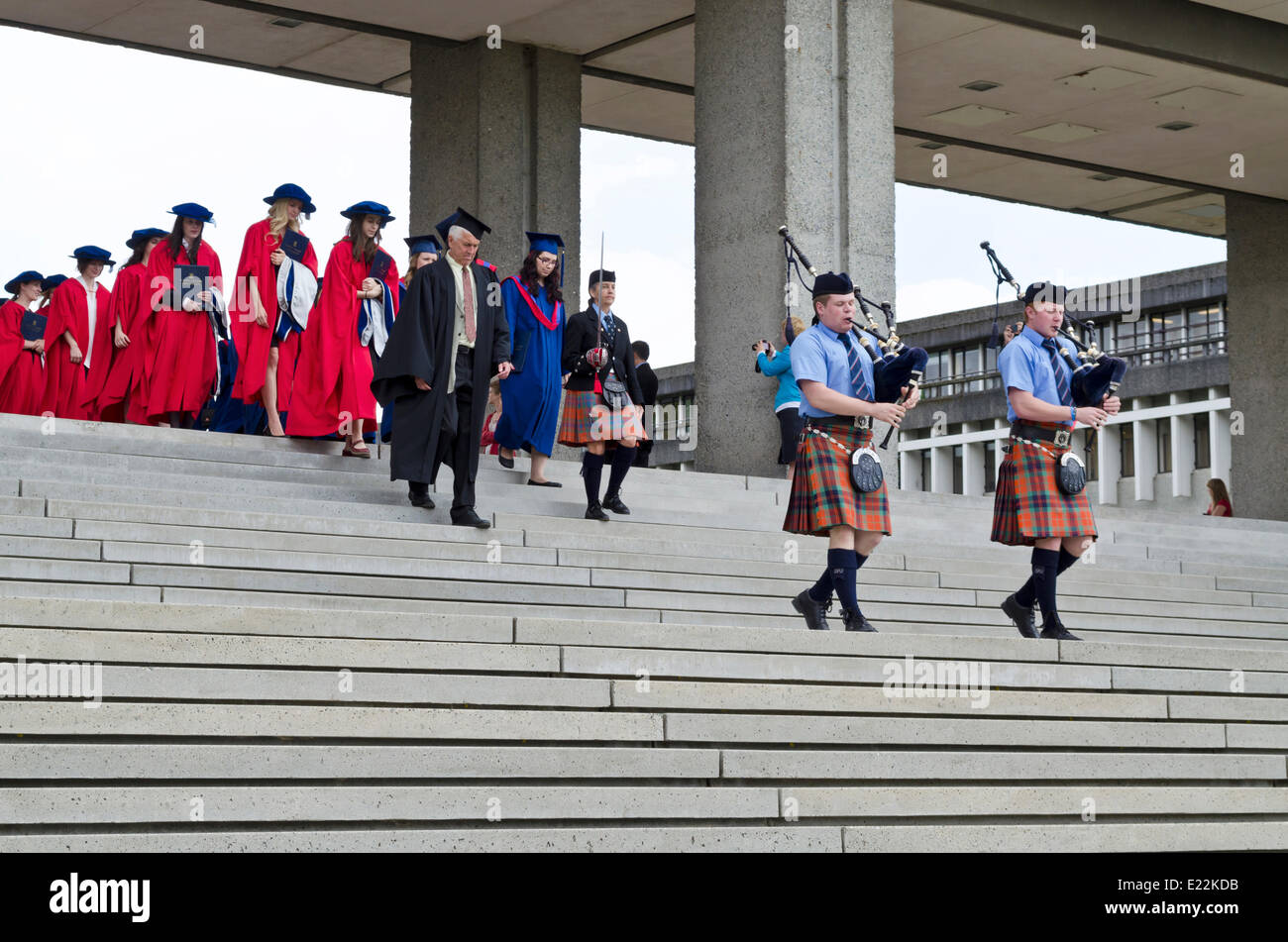 BURNABY, BC, CANADA.  JUNE 12, 2014:  Members of the Simon Fraser University Pipe Band lead the procession of graduands Stock Photo