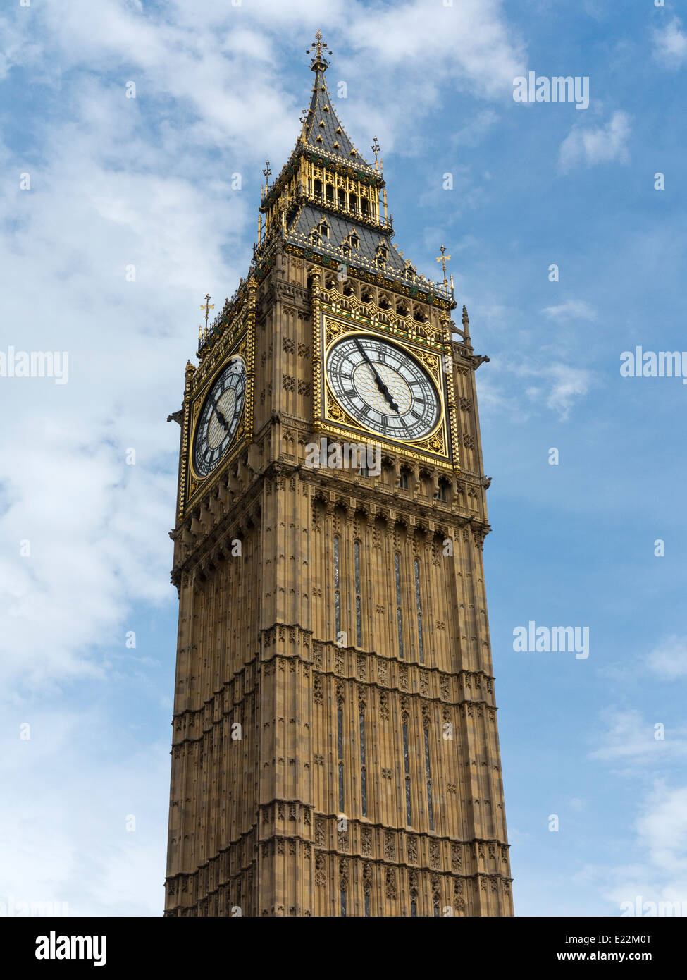 Upper section of Big Ben at the Palace of Westminster London England with the dial showing 4.55pm Stock Photo