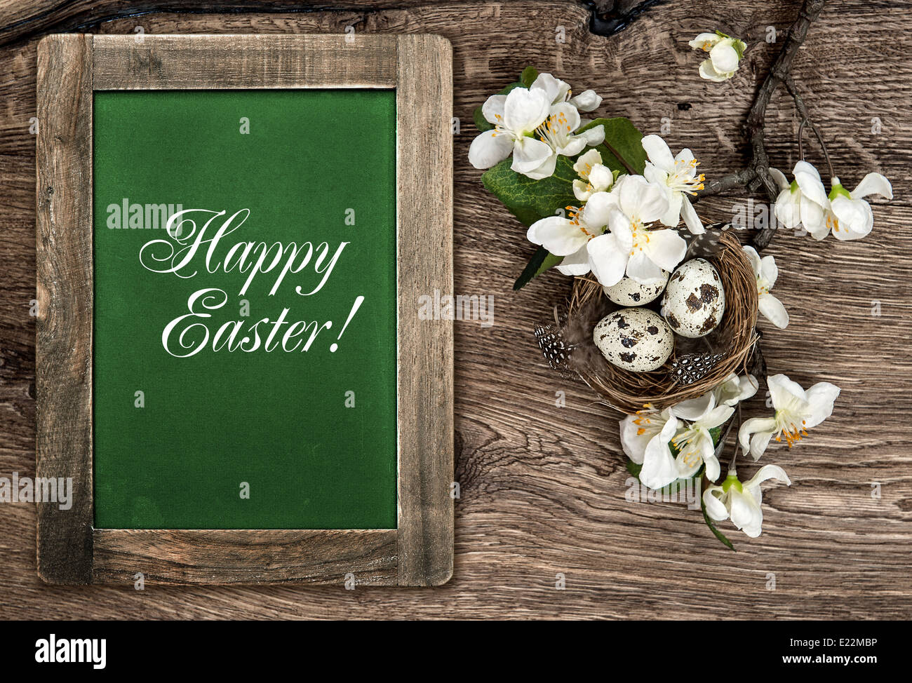 Chalkboard Flowers And Easter Nest With Eggs On Rustic Wooden Stock