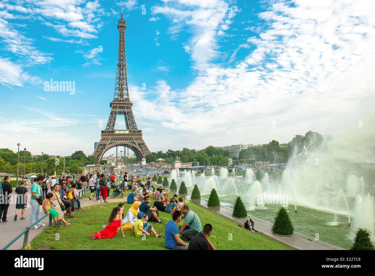PARIS - AUGUST 23: many tourists sitting near famous Eiffel Tower and enjoying the evening on August 23, 2013 in - Stock Image