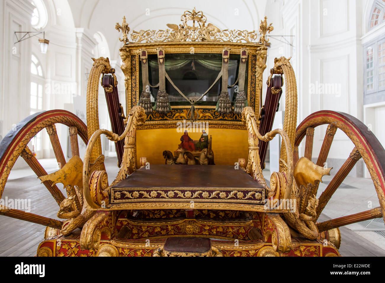 Italy. Old coach on luxury palace background. - Stock Image