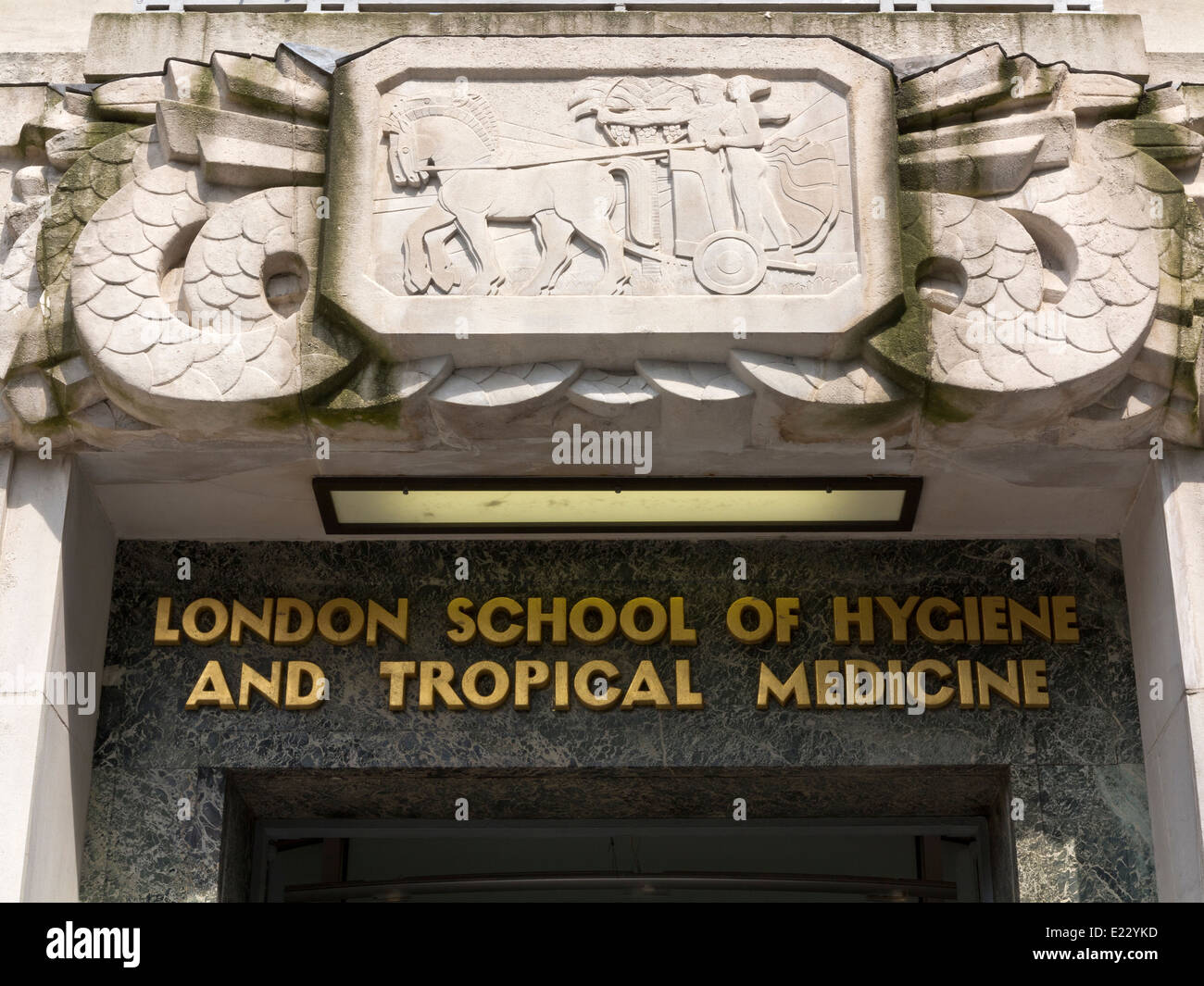 A carving of Apollo and Artemis riding a chariot above the main entrance of the London School of Hygiene & Tropical Stock Photo