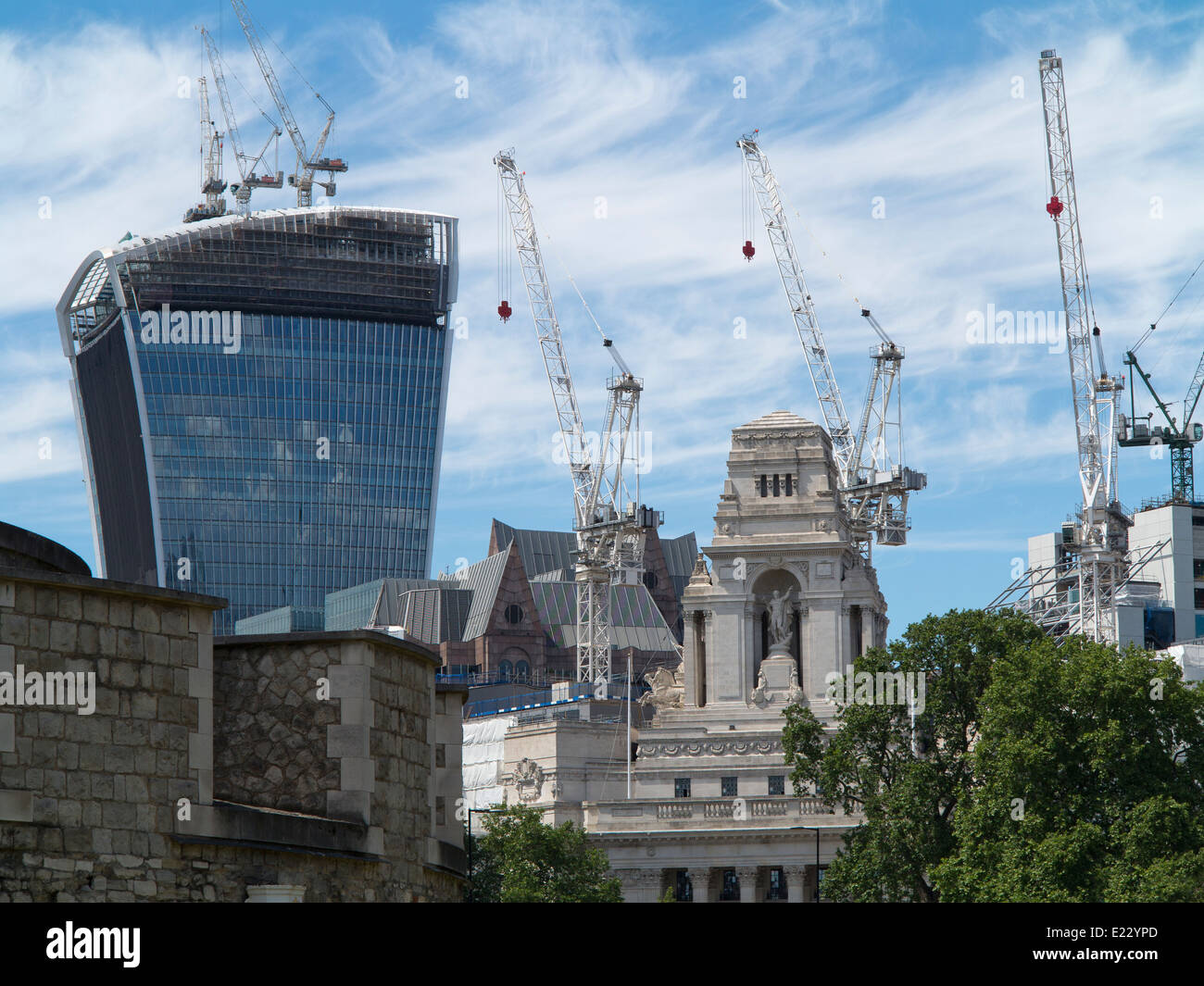 London skyline with mixed style and age buildings including The Walkie-Talkie skyscraper surrounded by cranes - Stock Image