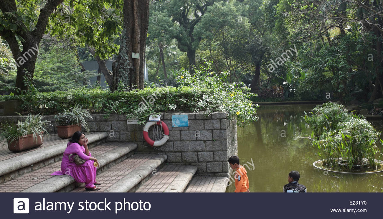 An Indian family playing in the Park in Kowloon, Hong King. - Stock Image