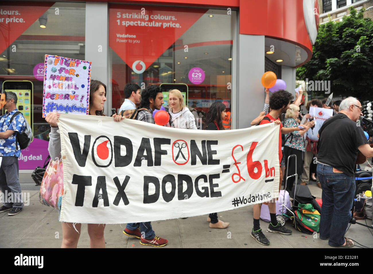 Oxford Street, London, UK. 14th June 2014. Protesters outside the Vodaphone shop on Oxford Street, part of a nationwide - Stock Image