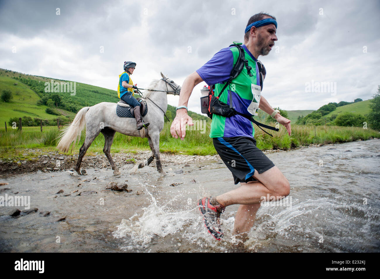 Llanwrtyd Wells, UK. Saturday 14 June 2014  Pictured: Runners and riders make their way through the course at the - Stock Image