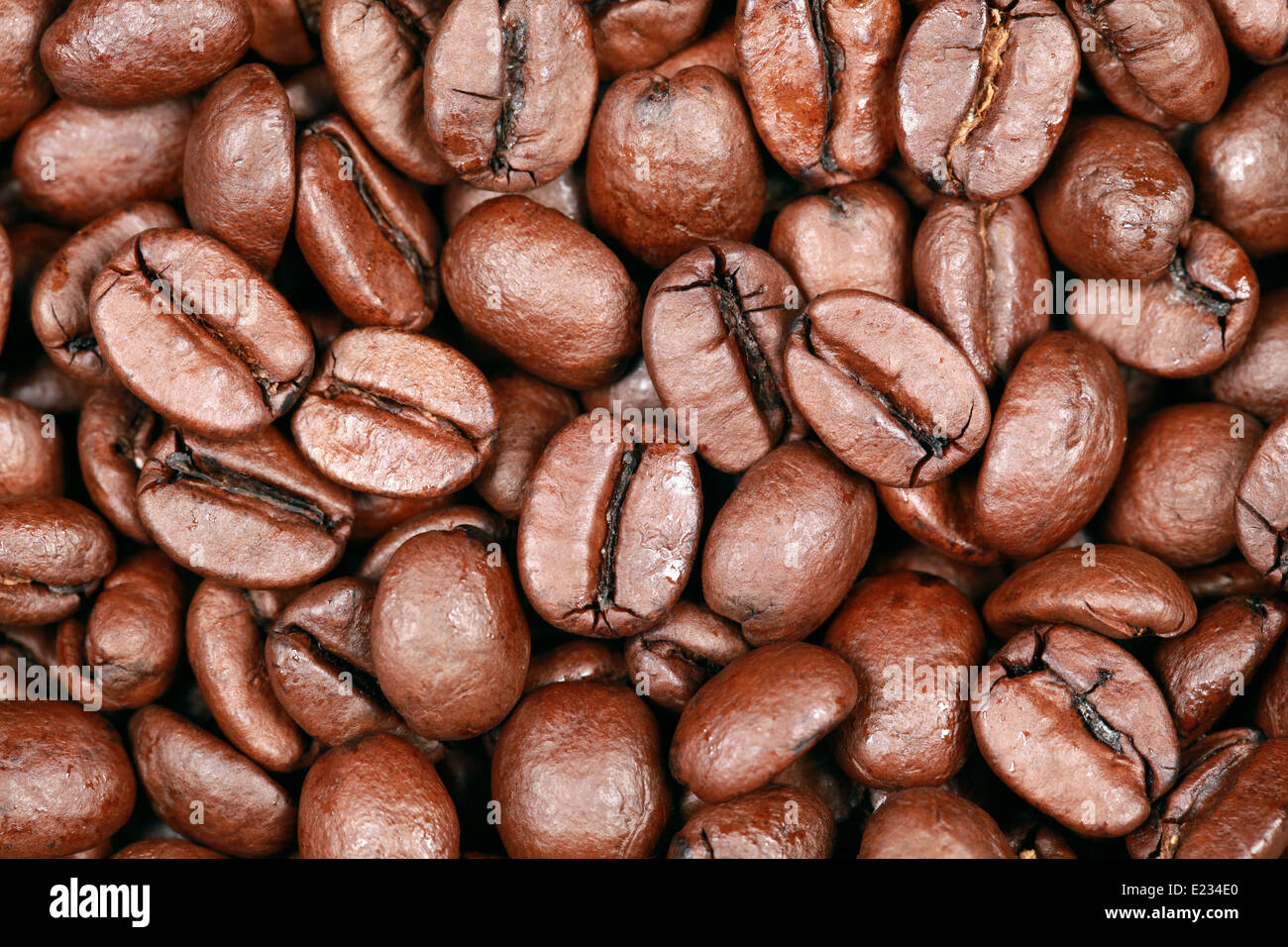 Group of coffee beans forming a background Stock Photo