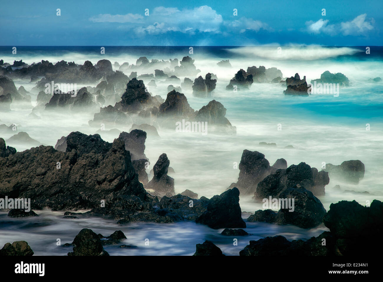 Volcanic seastacks with waves, Maui, Hawaii - Stock Image
