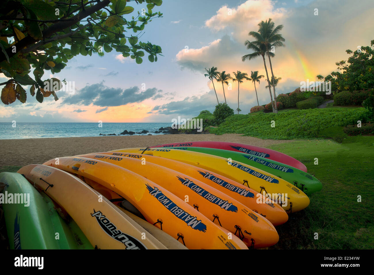 Kayaks on beach with rainbow. Maui, Hawaii - Stock Image