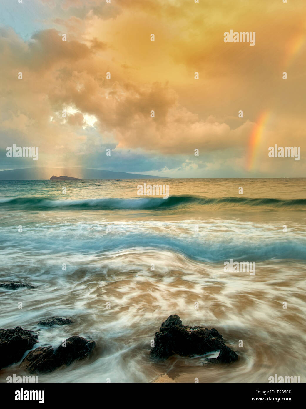 Maui coast with waves and rainbow with light and rain on Molokini. Hawaii - Stock Image