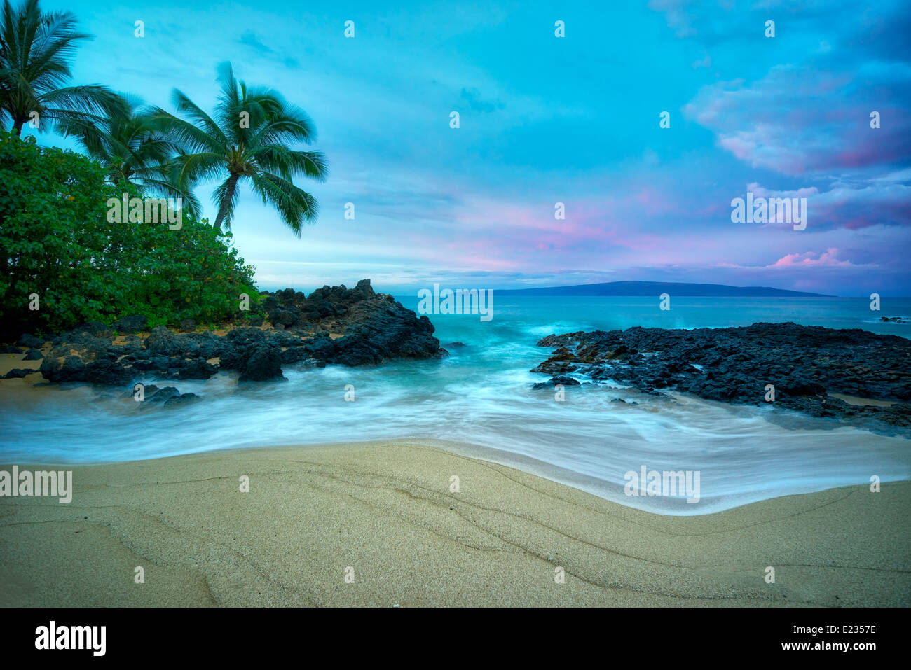 Secluded beach with palm trees and sunrise. Maui, Hawaii Stock Photo