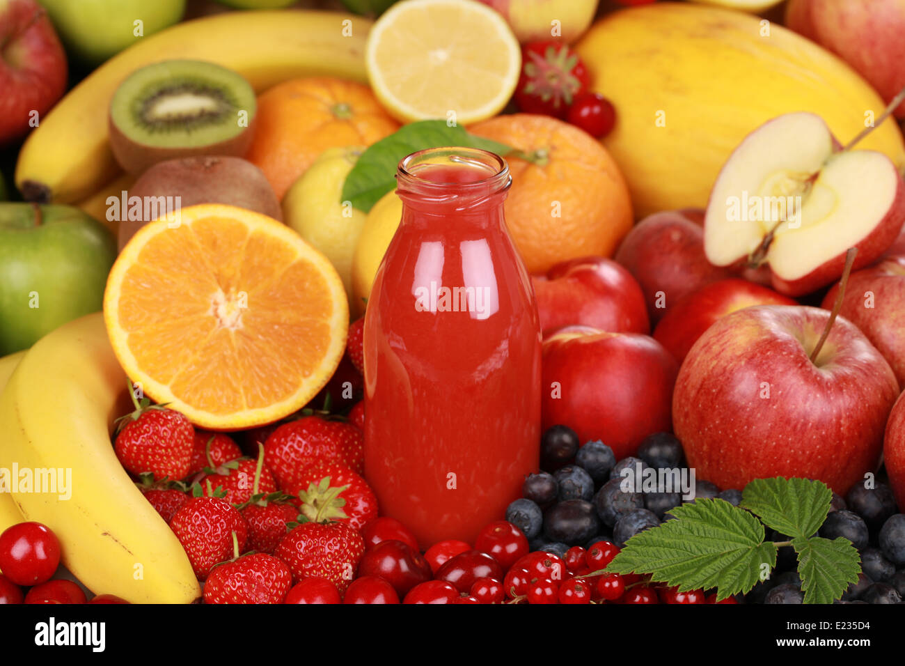 Freshly squeezed juice from red fruits in a bottle Stock Photo