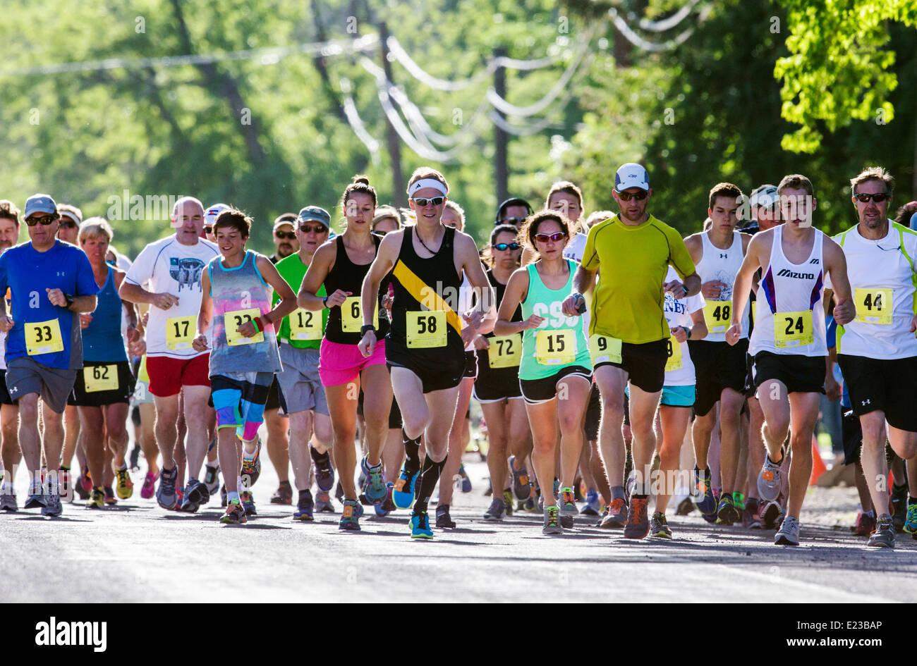Runners race in 5K & 10K foot races, annual Fibark festival, Salida, Colorado, USA - Stock Image