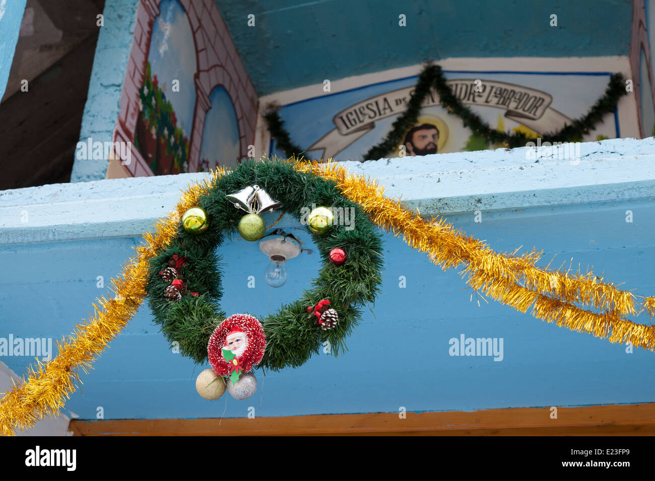 Secular holdiay decorations at the Church of San Isidro Labrador in the village of Macheros - Stock Image