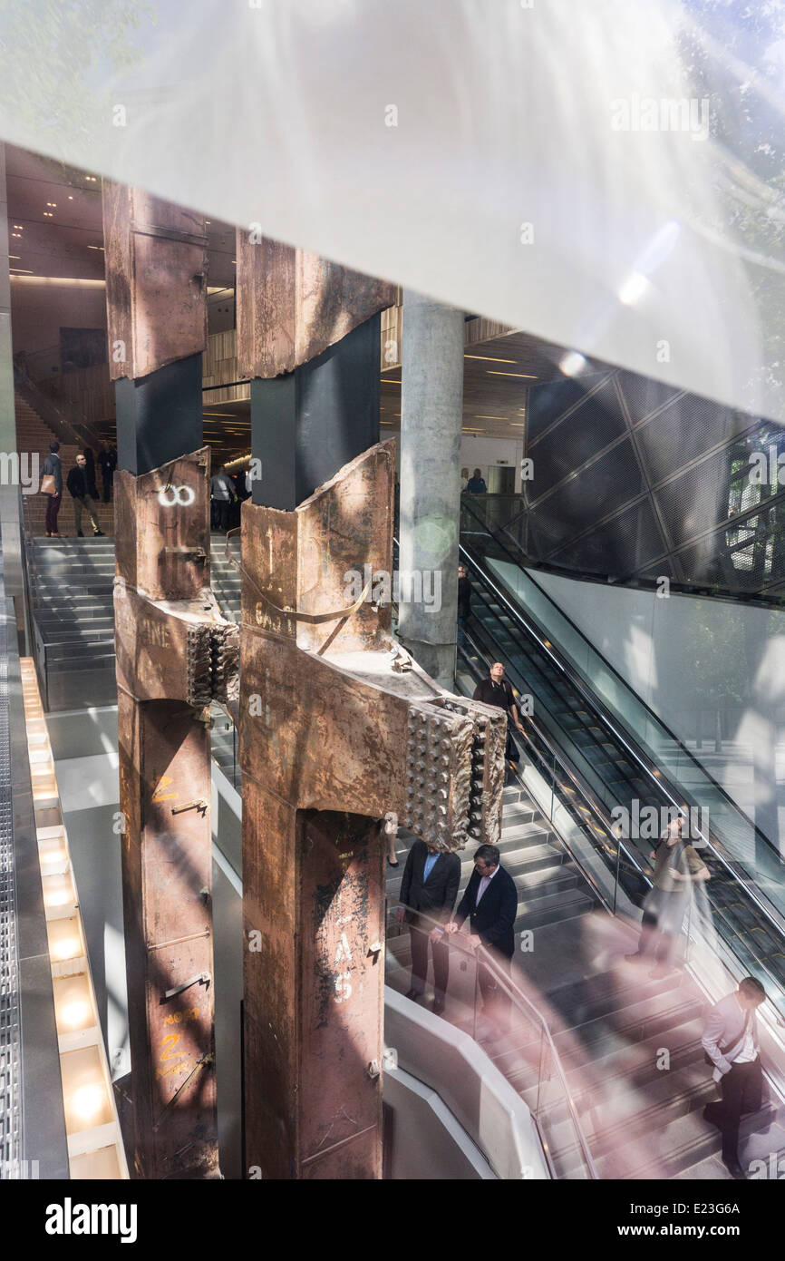 view through window monumental access stair to National September 11 Memorial Museum with 2 rusted column relics - Stock Image