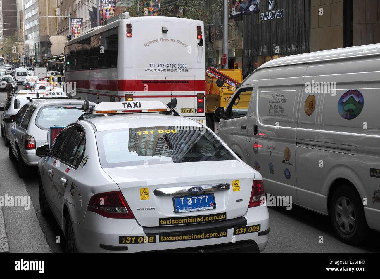 busy traffic congestion in Sydney george street, city centre,australia with taxis and coaches in the queue - Stock Image