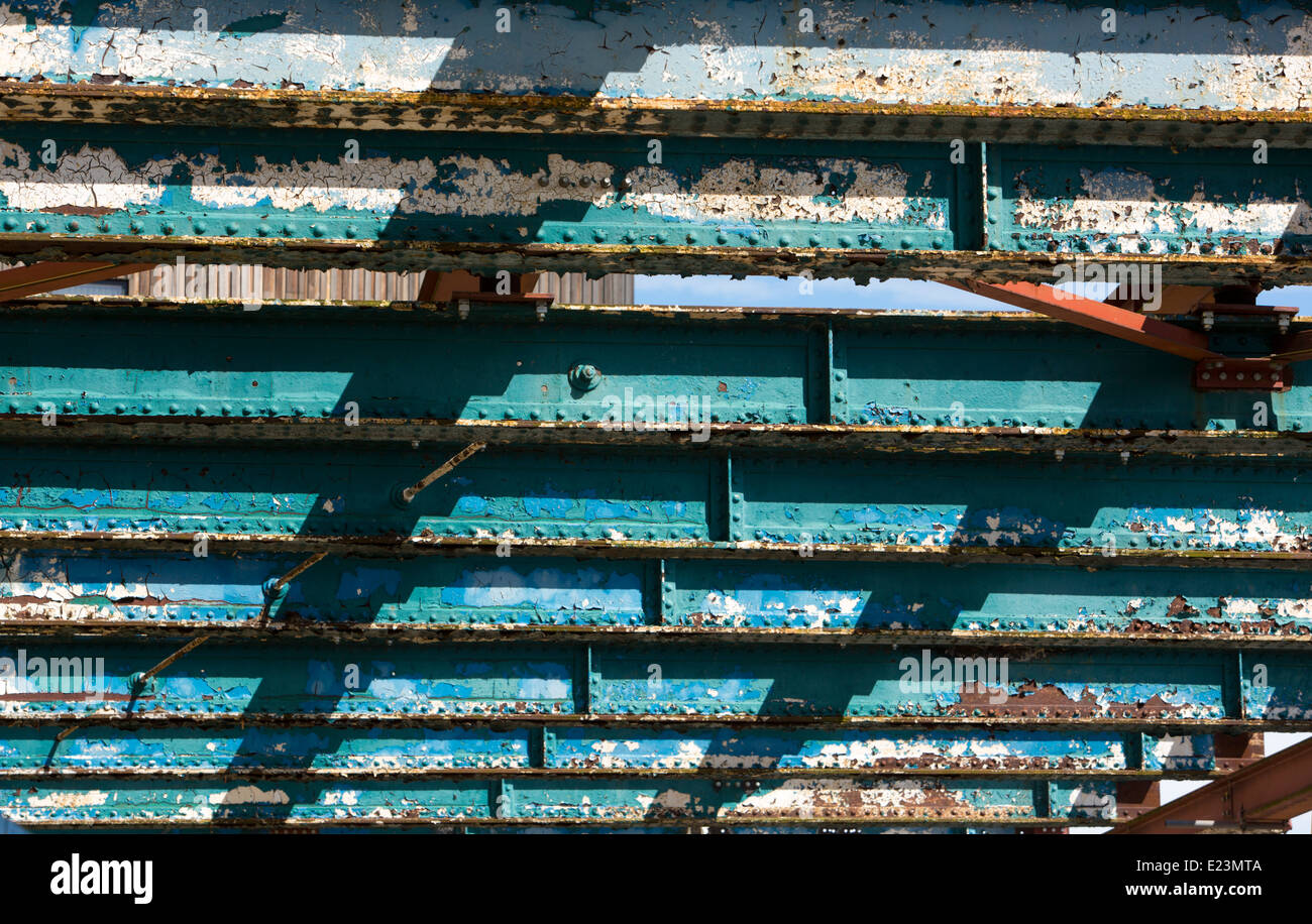 painted rusted flaking heavy metal load bearing girders on construction site Stock Photo
