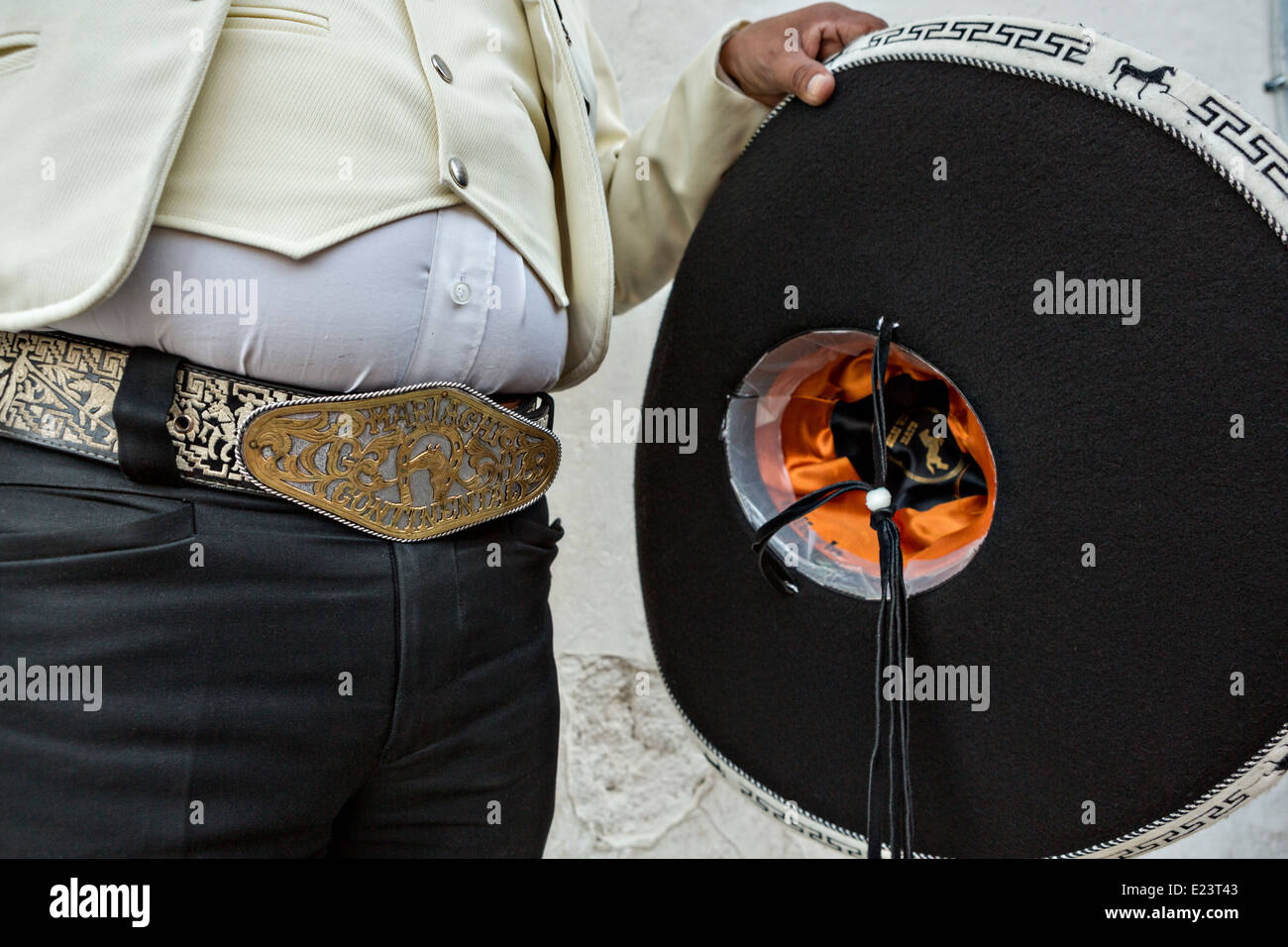 Cowboy belt buckle and sombrero of a Mexican mariachi dressed in  traditional charro costume November 5 7d5ec42920d