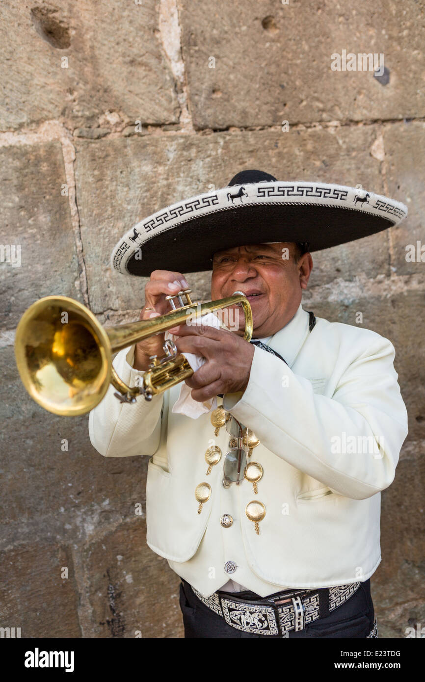 A mariachi band member dressed in traditional charro costume November 5, 2013 in Oaxaca, Mexico. - Stock Image