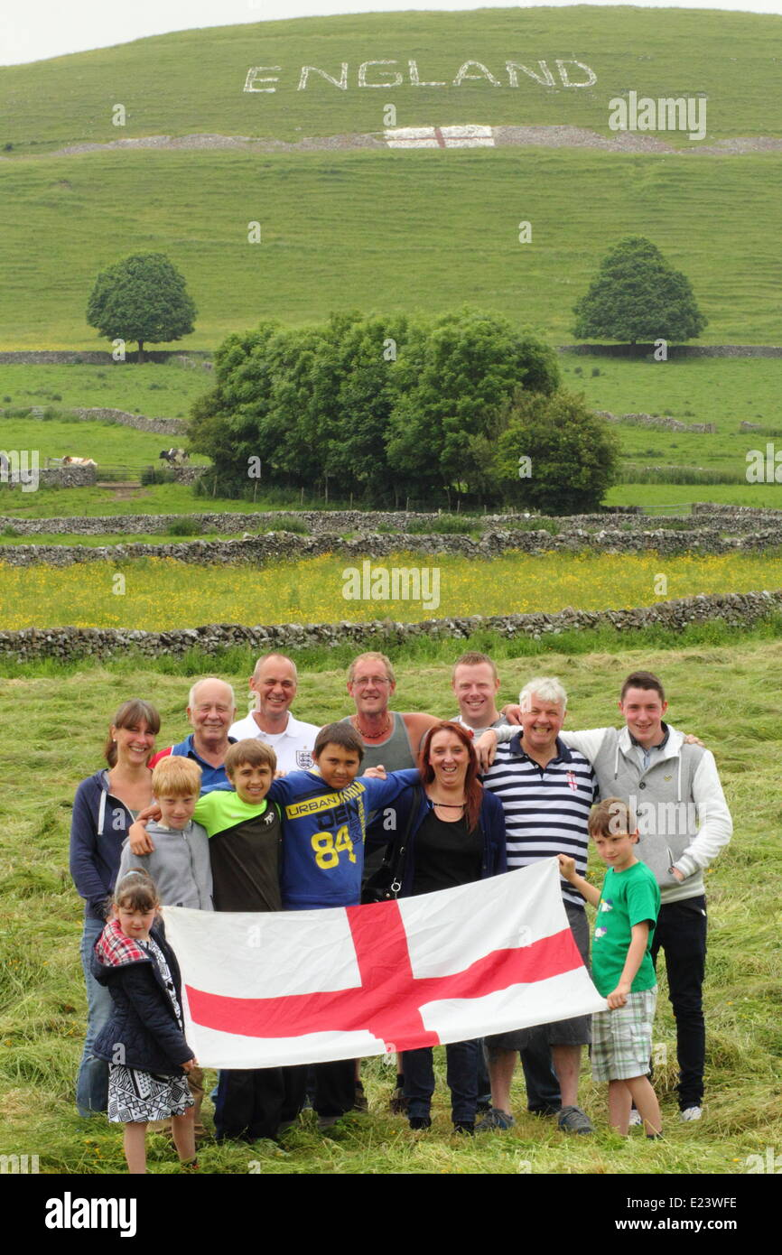 Peak District, Derbyshire, UK.  15 June 2014.  Members of a group of 15 villagers who have created a   sign in on - Stock Image