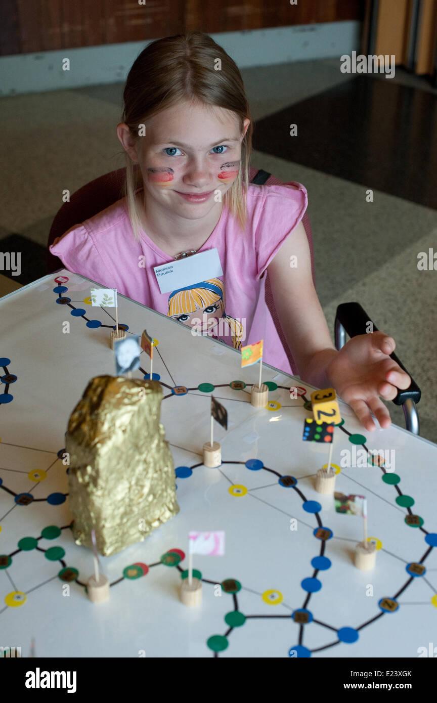 12-year-old game designer Melissa Paulick plays her new game 'Gehirnjogging auf dem Weg zum Einstein' ('Brain - Stock Image