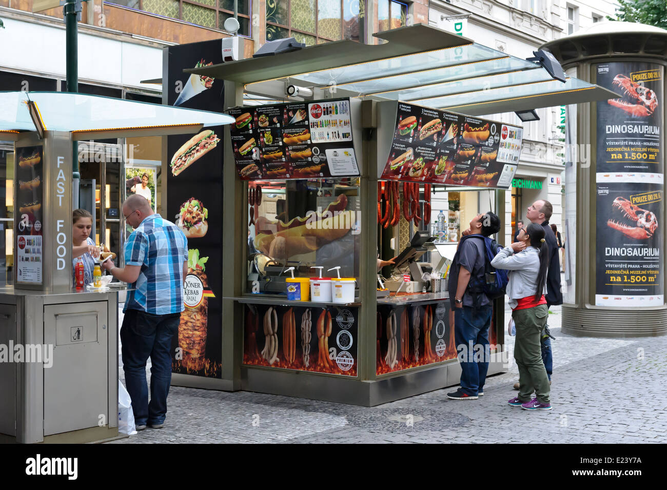 Tourists eating and choosing fast food from a Kiosk on Prague street