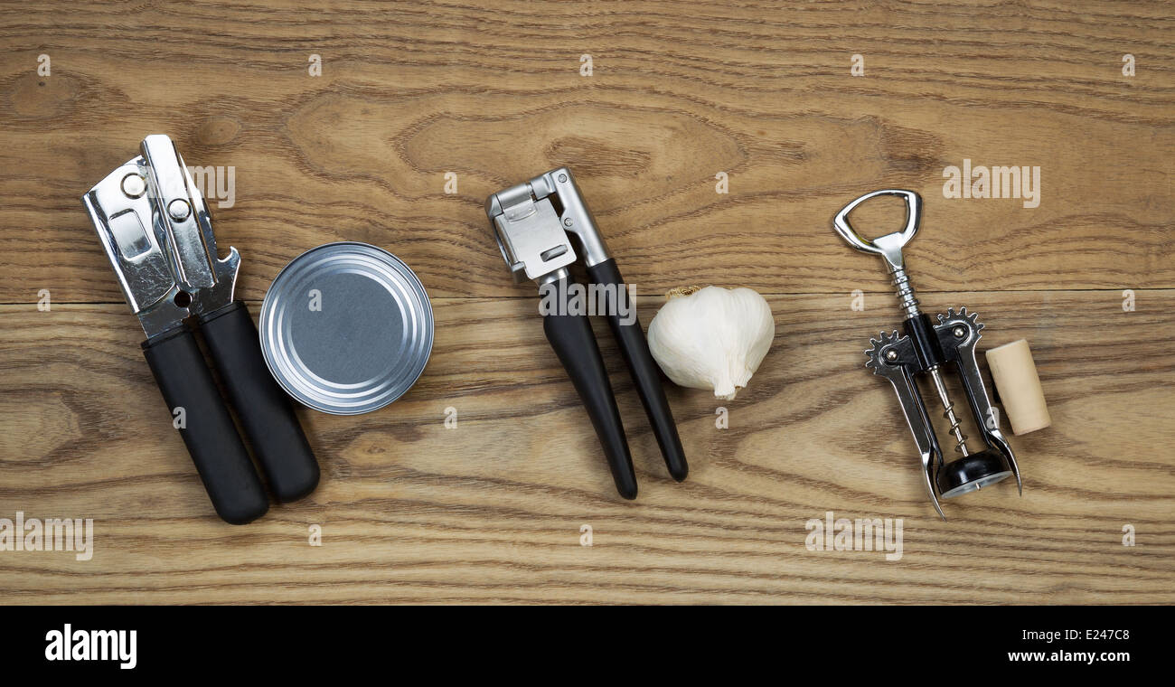 Overhead view of basic kitchen utilities with matching item for use placed on rustic wood - Stock Image
