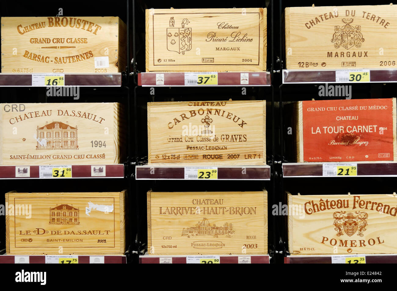 Wooden boxes of expensive wine in a French supermarket - Stock Image