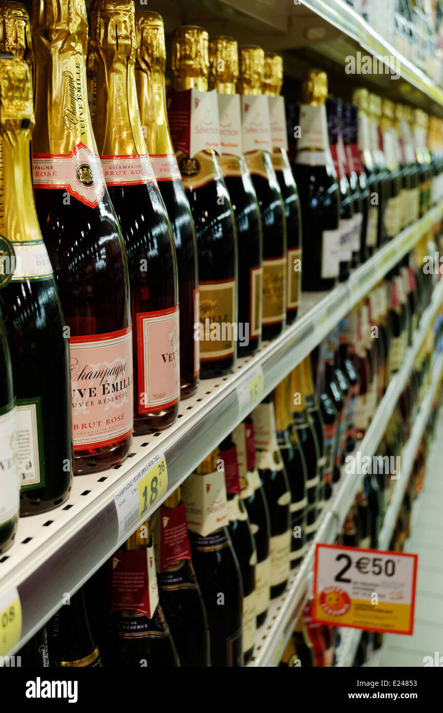 Bottles of Champagne on the shelves of a supermarket in France - Stock Image