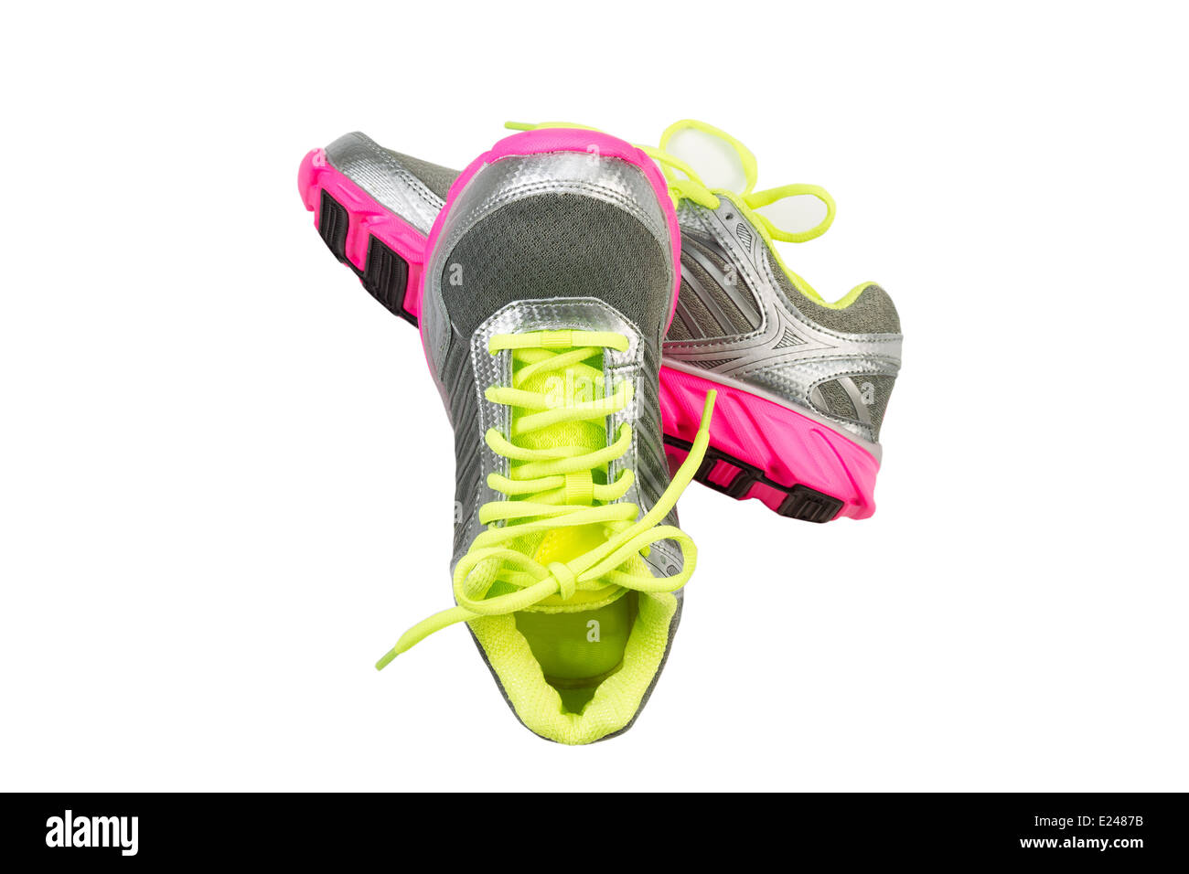 New work out shoes in bright green, silver and pink colors isolated on white - Stock Image