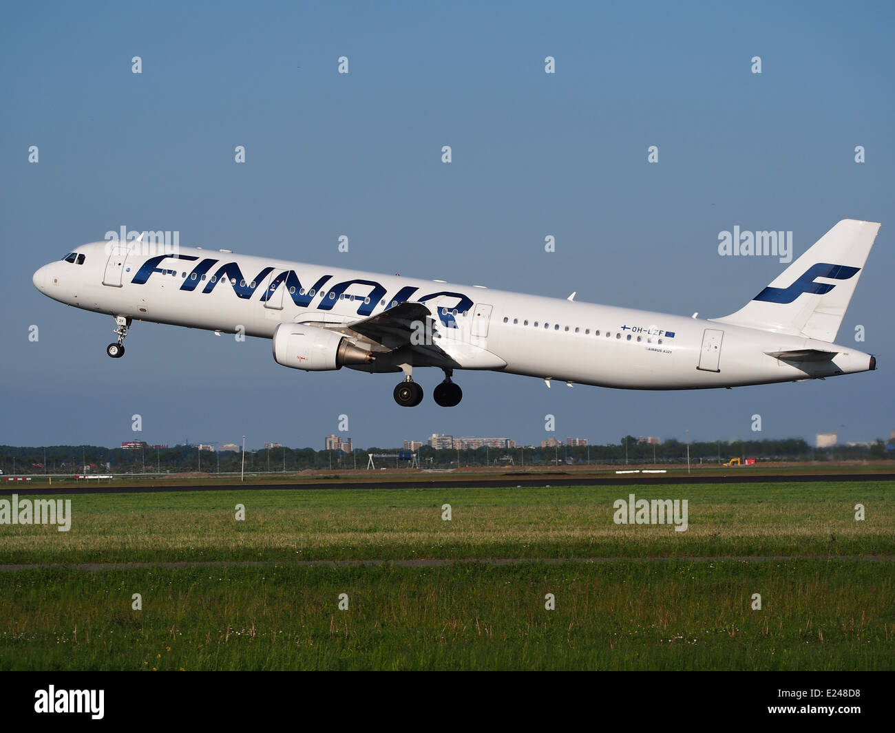 OH-LZF Finnair Airbus A321 takeoff from Schiphol (AMS - EHAM), The Netherlands, 16may2014, pic-2 - Stock Image
