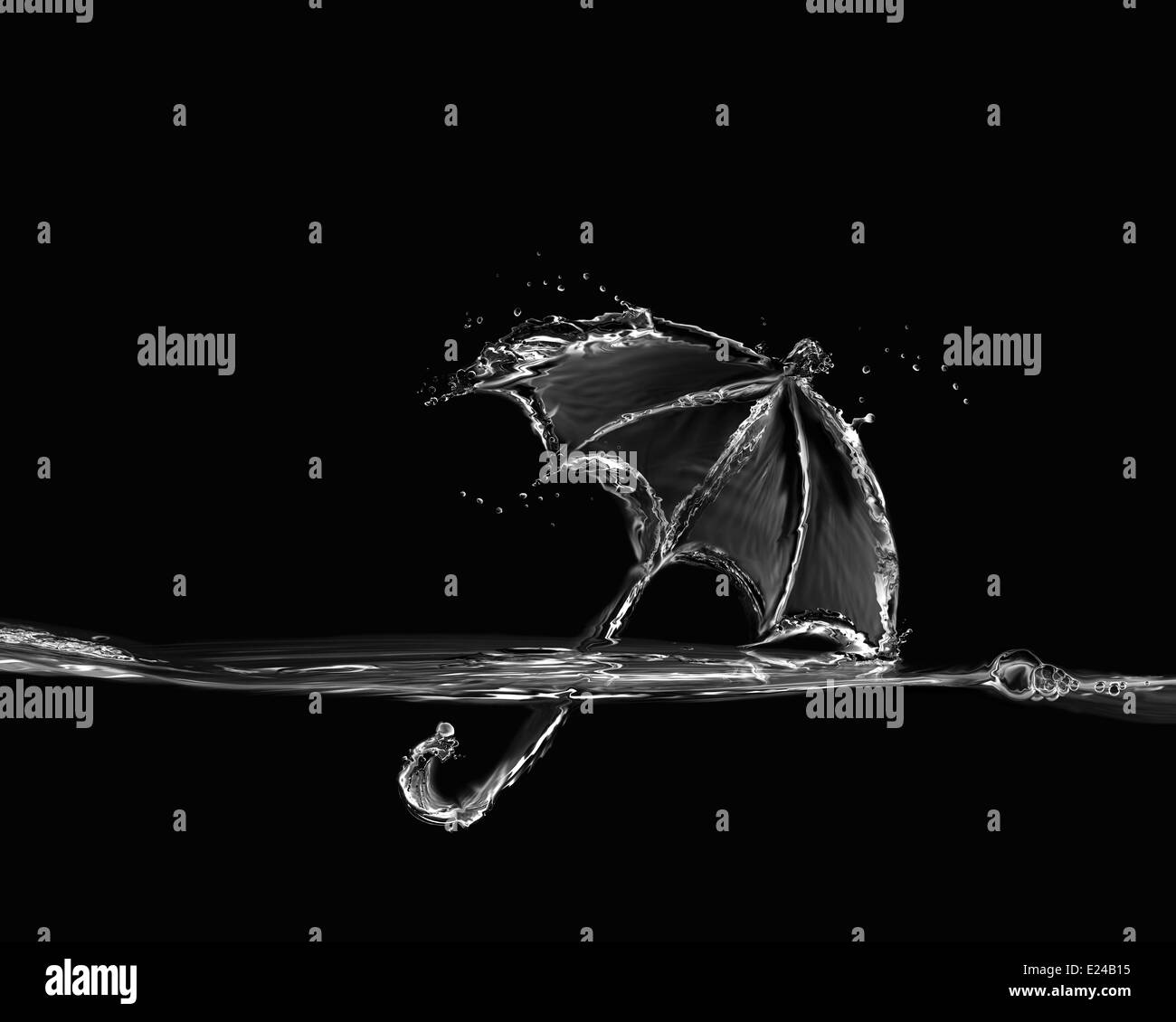 A black and white umbrella made of water and floating on water. - Stock Image