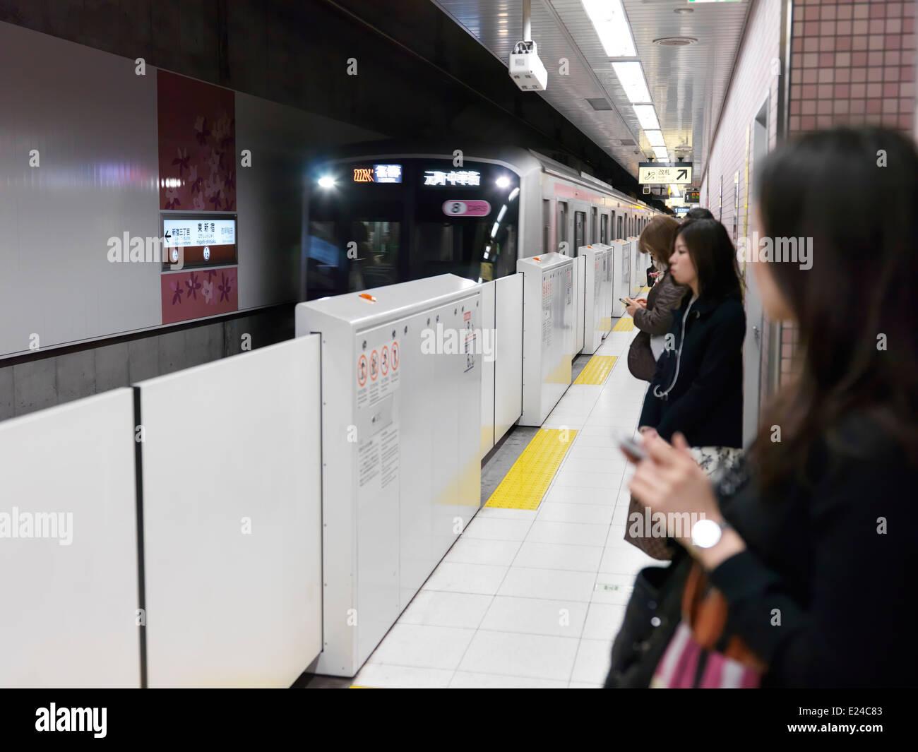 Tokyo Metro subway train arriving to a platform in Tokyo, Japan. - Stock Image