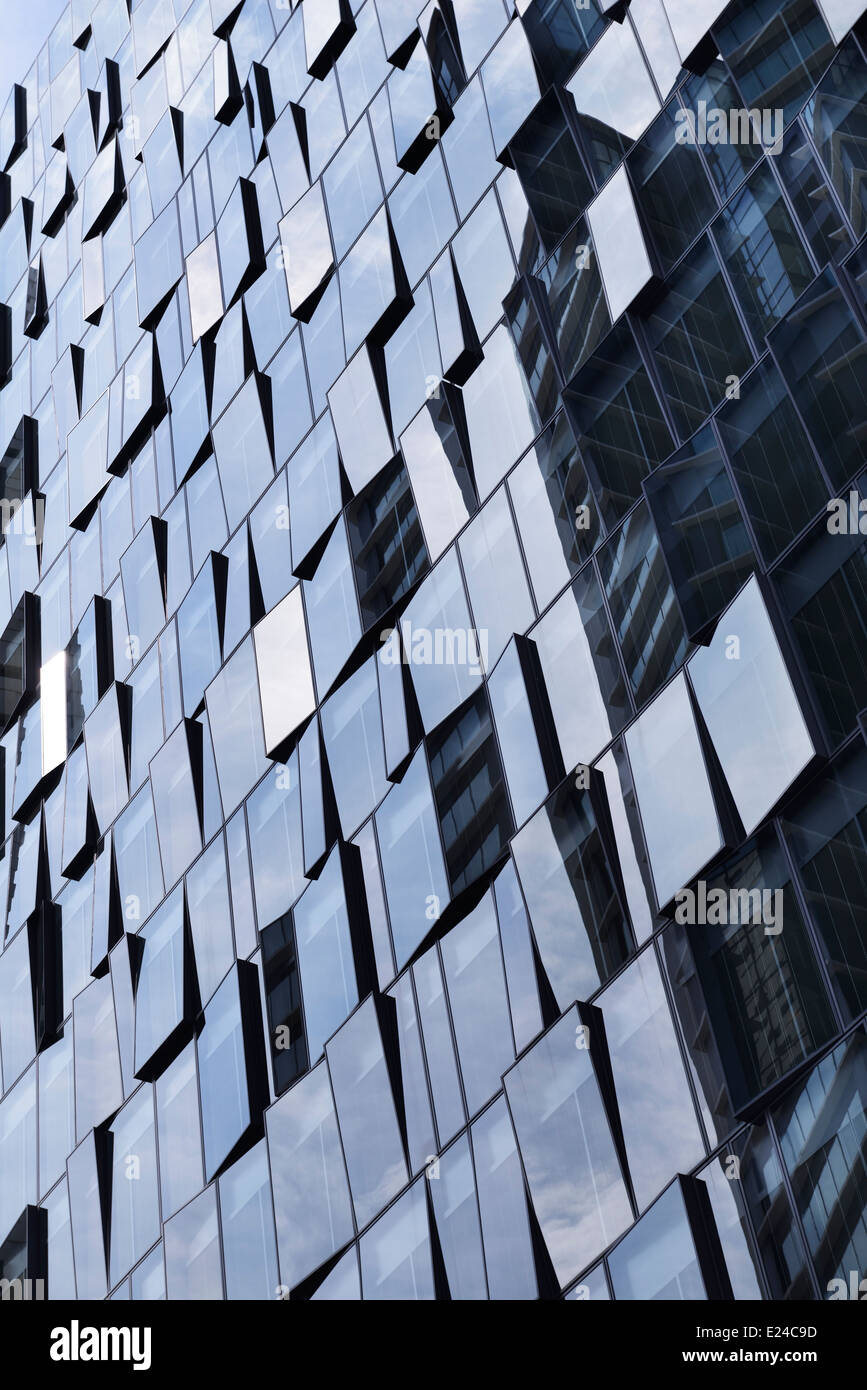 Modern glass office building wall abstract background. Tokyo, Japan. - Stock Image