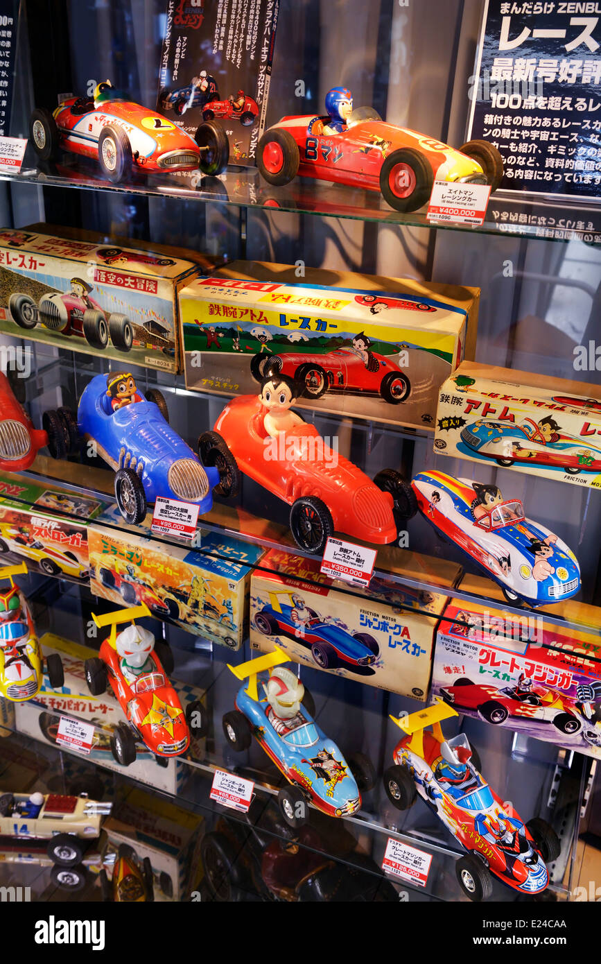 Collectible retro race toy cars, anime characters in Tokyo, Japan. Astro boy and other racing cars. - Stock Image