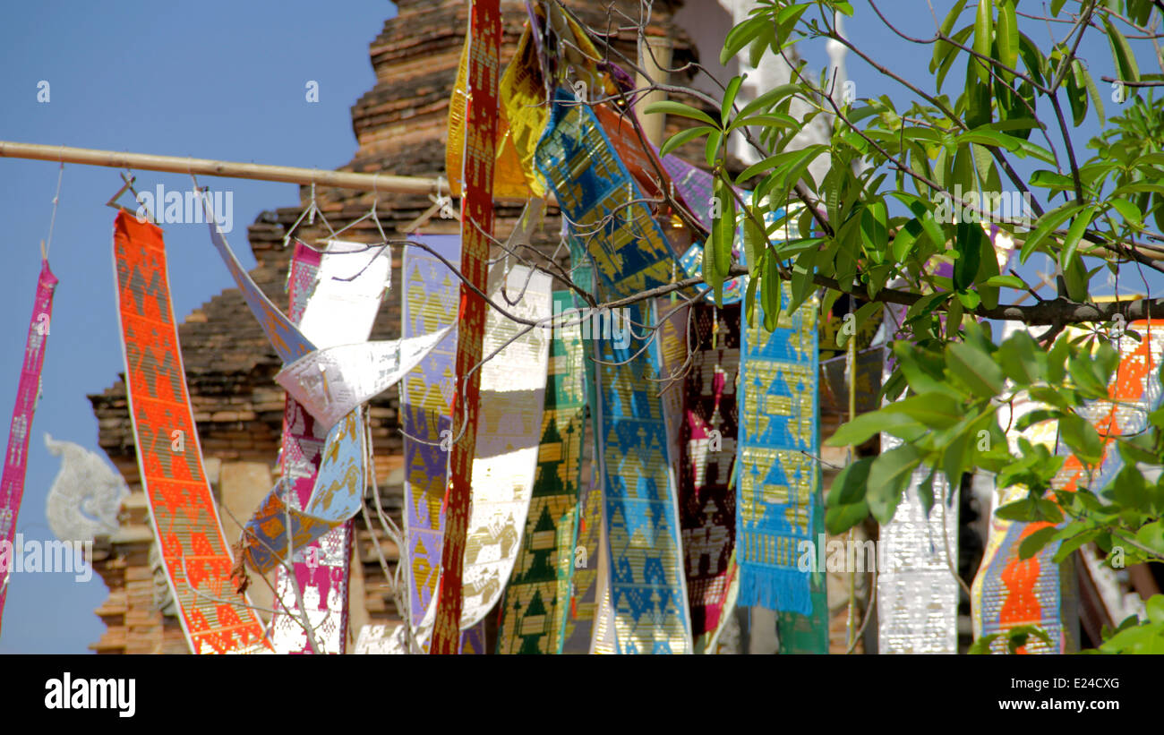 Hanging prayer banners at Buddhist Temple in Chiang Mai, Thailand - Stock Image